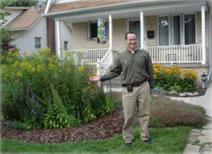 Photo of a man showing his Yard Rain Garden